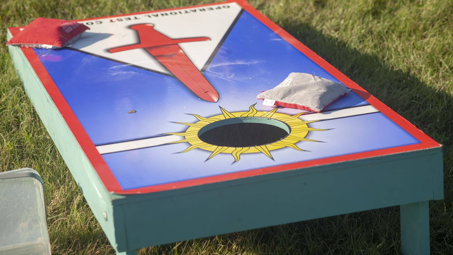A Baggo game with an Operational Testing Command logo imprinted on it